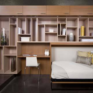 Office Space with Built in Murphy Bed and Desk and Light Wood Cabinets and Shelving