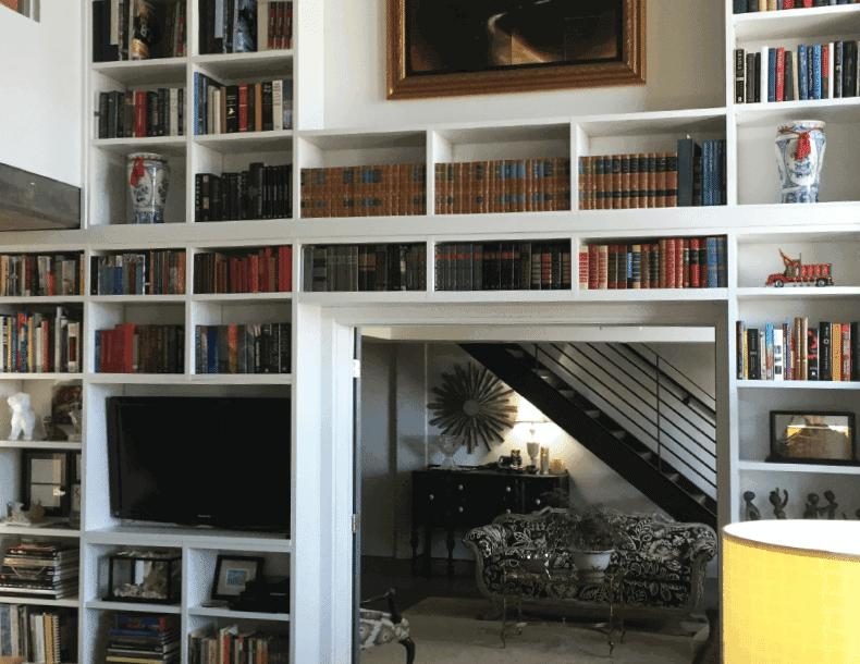 White Floor To Ceiling Library Shelving and Media Center