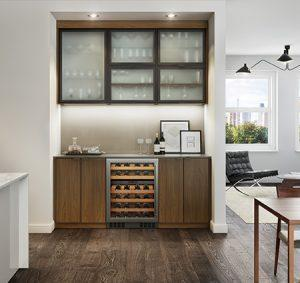 Dark Wood Built In Bar Nook with Frosted Glass and Solid Wood Cabinet Doors Puck Lighting and Stainless Steel Wine Fridge