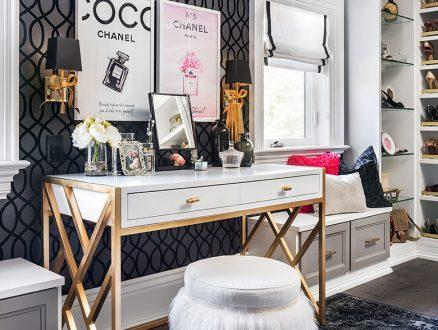 Walk in Closet with White Shoe Racks and Drawer Glass Shelves and White Vanity Desk With Gold Accents